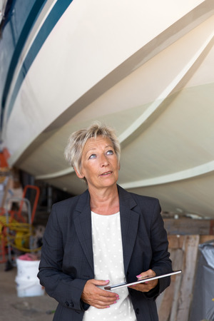 reputable: Businesswoman in a senior position giving an opinion on a shipyard Stock Photo