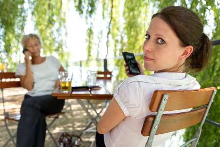 beer garden: two businesswomen making a break in a beer garden, concept outdoor meeting