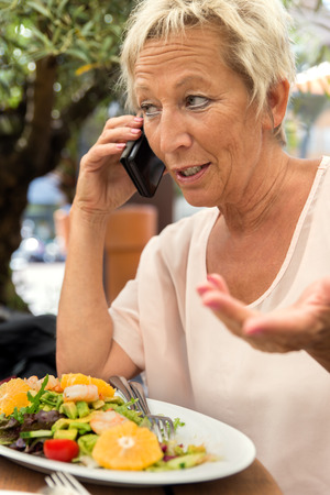 reputable: woman is calling during a break in the restaurant, concept businesswoman and nutrition