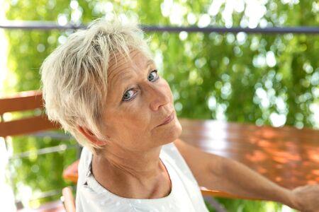 beer garden: Portrait of a attractive older woman in the beer garden
