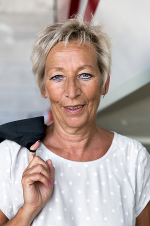 quota: Portrait of a attractive older Business woman in a depot Stock Photo