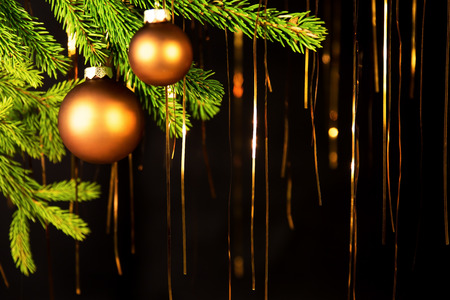 brushwood: golden christmas background with balls, fir branch and tinsel