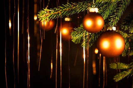 brushwood: black christmas background with balls and tinsel Stock Photo