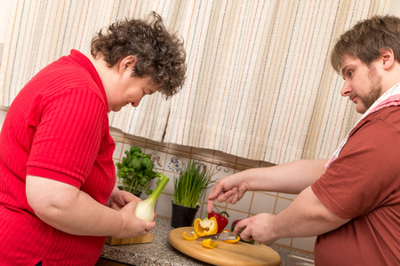 mentally: a mentally disabled woman learns cooking in the kitchen