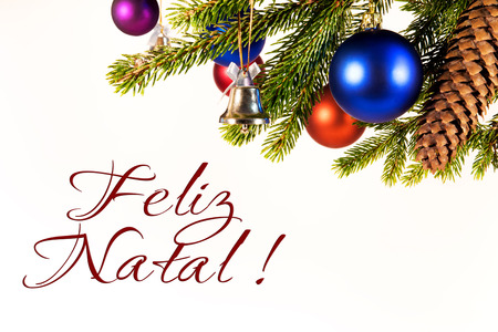 natal: christmas background with decoration on white, portuguese words for frohe merry christmas, feliz natal Stock Photo
