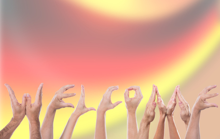recourse: Word Welcome formed with a lot of hands, German Flag in the Background, concept Refugee and Help Stock Photo