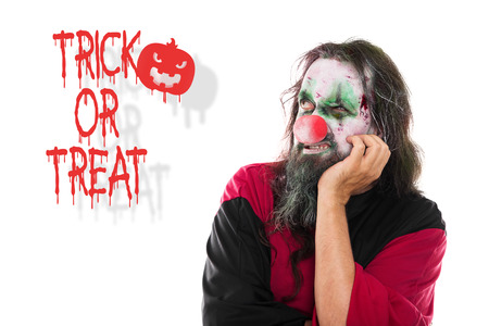 scary clown: scary clown looking to Text Trick or Treat, isolated on White, Concept Halloween and Party
