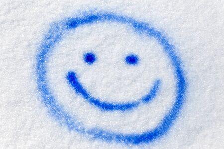 sprayed: blue funny smiley sprayed in the snow Stock Photo