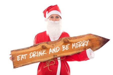 essen: Santa Mädchen mit einem Holzbrett mit Text essen trinken und fröhlich, isoliert auf weiß, Konzept Weihnachtsessen Lizenzfreie Bilder