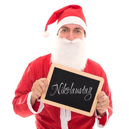 st german: Santa Claus holding a board with german Word Nikolaustag, isolated on White, concept st. nicholas day