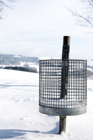 waste products: Trash can at the snow, concept winter tourism Stock Photo