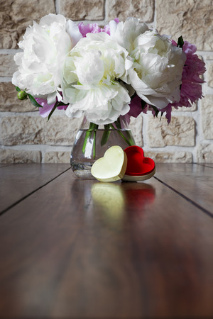 love proof: a romantic bouquet of peony roses and a heart box Stock Photo