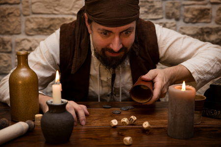 a Pirate is gambling with dice on a medieval table, concept luck and success