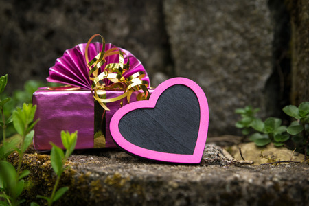 rockery: a pink heart and present on a vintage rockery