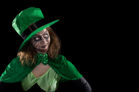ireland: Leprechaun girl looking to copyspace, concept ireland and st. patrick´s day