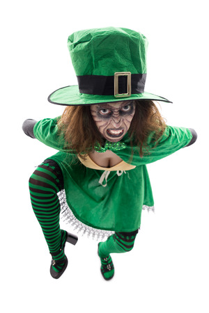 madly: a madly leprechaun, isolated on white, concept st. patrick�s day or halloween Stock Photo