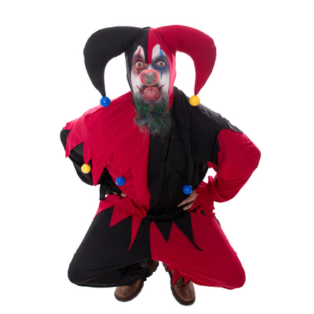 Evil clown: evil jester sticking out his tounge, isolated on white Stock Photo
