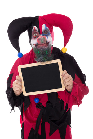 madly: a madly clown holding a slate with copyspace, isolated on white Stock Photo