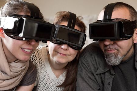 three persons: portrait of three persons with virtual reality glasses
