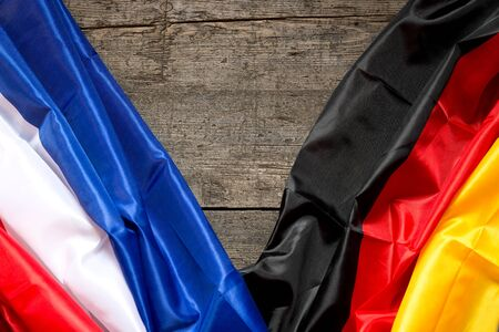 neighboring: France and Germany Flag on a wooden Background, concept Partnership and friendship