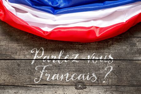 french text: France Flag on wooden background with french Text, Concept Language and Communication Stock Photo
