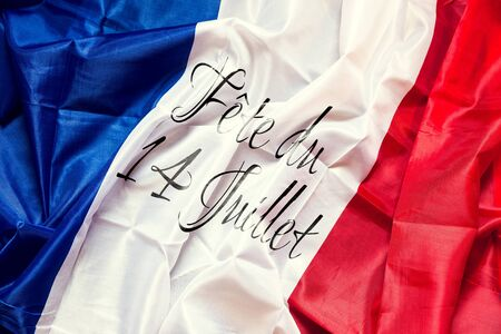 14th: wrinkled france Flag with french text, Concept National day of 14th July Stock Photo