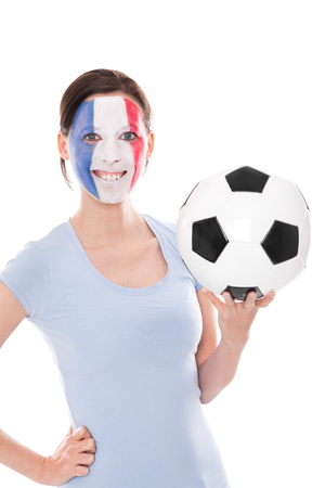 female soccer: female soccer fan from France holding a football, isolated on white