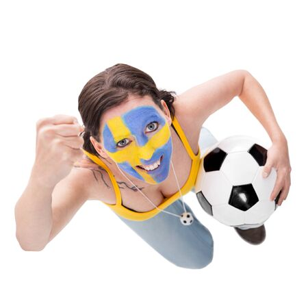 cheerfully: cheerfully female swedish soccer fan with a football, isolated on white Stock Photo