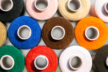 thread count: lot of colorful sewing thread, closeup with details Stock Photo
