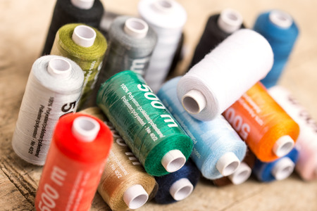 sewing cotton: colorful sewing cotton on wooden table