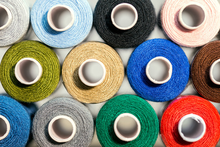 thread count: Closeup, a lot of colorful sewing thread, details