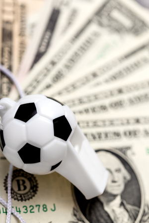 bets: soccer whistle on dollar notes, concept sport bets, or corruption Stock Photo