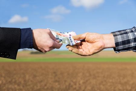 a businessman and farmer with a money transfer