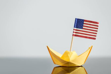 central bank: paper ship with usa flag, concept shipment or free trade agreement, travel Stock Photo