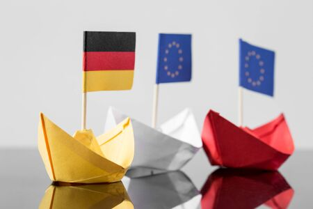 paper ship with german and european flag, concept shipment or free trade agreement and membership of eu Stock Photo