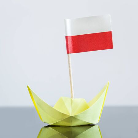 EU: paper ship with polish flag, concept shipment or free trade agreement Stock Photo