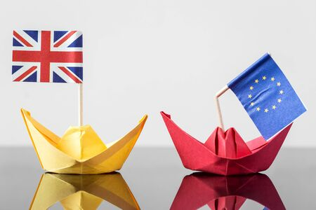 paper ship with british and european flag, concept shipment or free trade agreement and membership of eu, brexit Stock fotó - 56911262