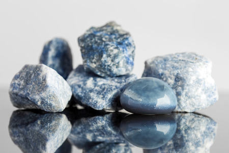 crystal healing: Blue sodalite, uncut and tumble finished, reflections, crystal healing