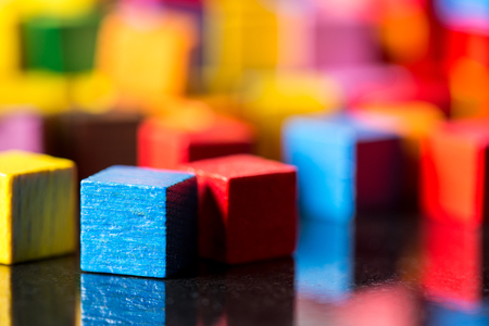 closeup, lots of colorful toy blocks with reflections
