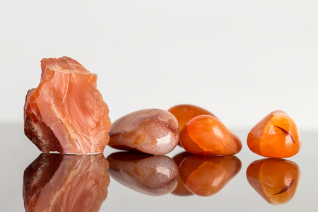 carnelian: red carnelian, uncut and tumble finished, reflections, concept cyrstal healing