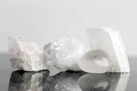 energy healing: quartz crystal uncut and tumble finished, reflections, concept healing and engery