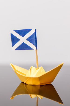 scotish: paper ship with scots flag, concept independence and travel Stock Photo