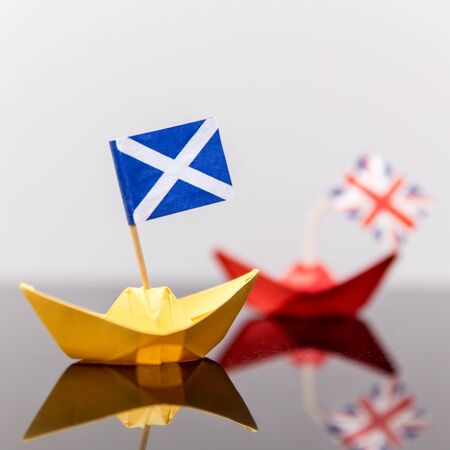 scotish: paper ship with british and scots flag, concept shipment or free trade agreement and membership of eu, independence referendum