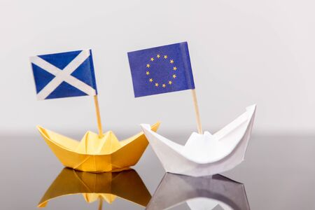 scots: paper ship with european and scots flag, concept shipment or free trade agreement and membership of eu, independence referendum, scoxit or scexit Stock Photo