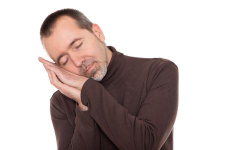 asleep: a caucasian man is sleeping standing up Stock Photo
