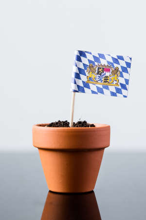 economy growth: flag of bavaria in a plant pot, concept economy growth Stock Photo