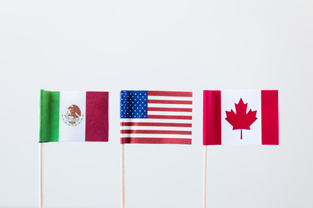 Les drapeaux des trois membres nafta Banque d'images - 60191182