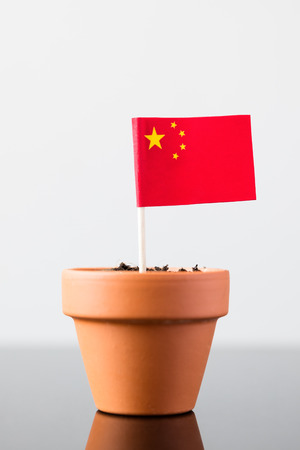 population growth: flag of china in a plant pot, concept economy growth