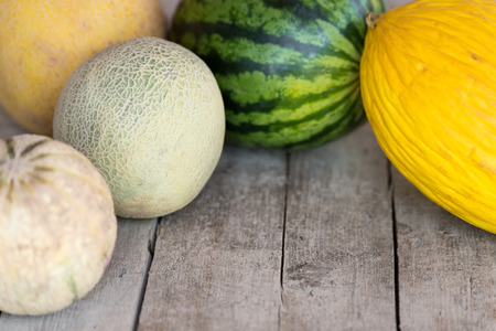 ripe: five different melons on a wooden table