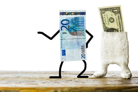 Concept weak dollar, strong euro, plastered banknote